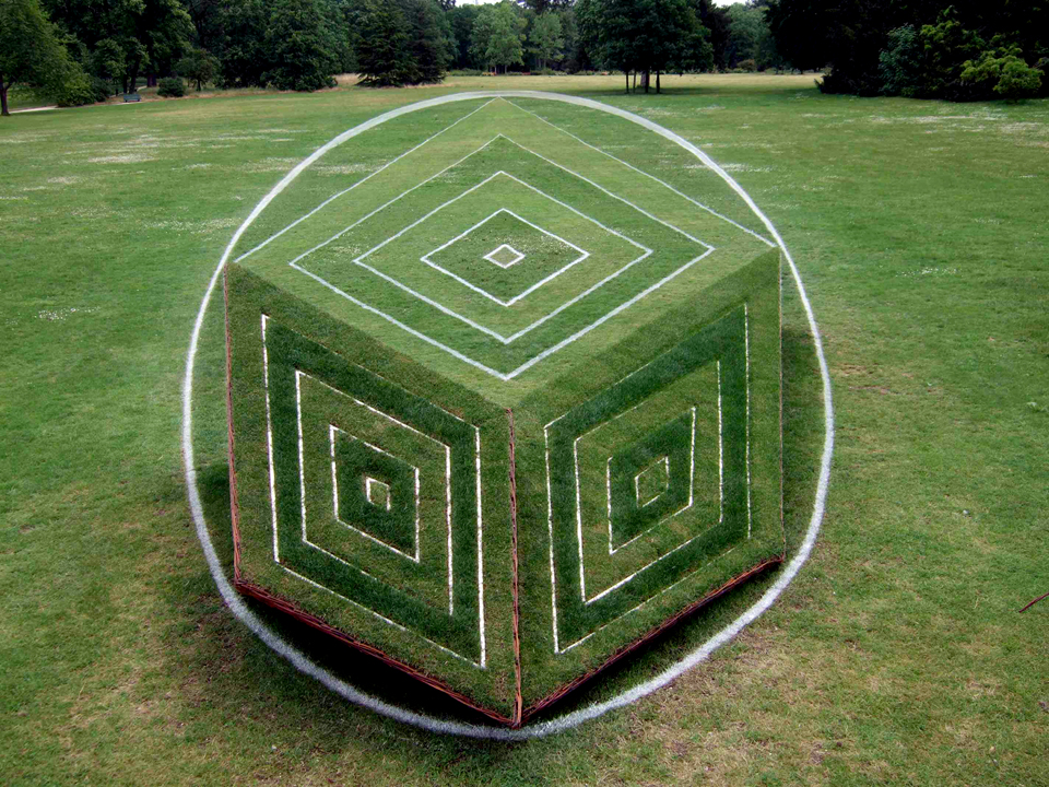 3d cube in anamorphosis into Bagatelle garden. Anamorphose vegetale